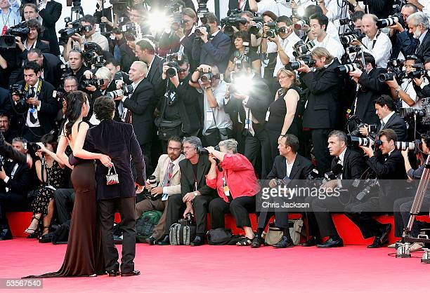 Hong Kong actor Donnie Yen and his partner attend the Opening Gala and 'Seven Swords' premiere at the Palazzo del Cinema on the first day of the 62nd...