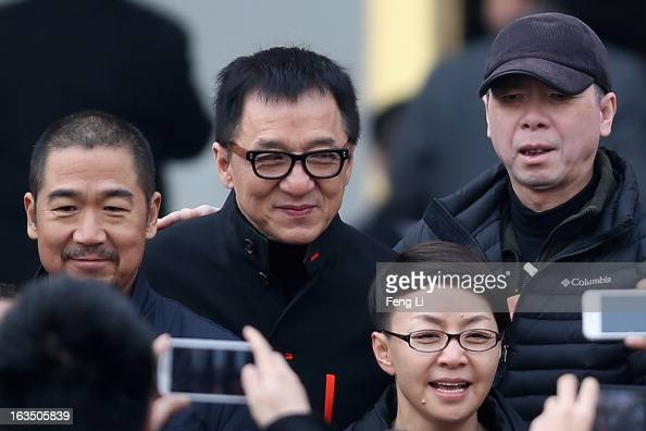 Hong Kong actor Jackie Chan Chinese actor Zhang Guoli Chinese director Feng Xiaogang and Chinese actress Song Dandan arrive at a plenary session of...