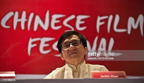Hong Kong actor Jackie Chan gestures during a press conference at the Chinese Film Festival in New Delhi on June 18 2013 Hong Kong actor and...