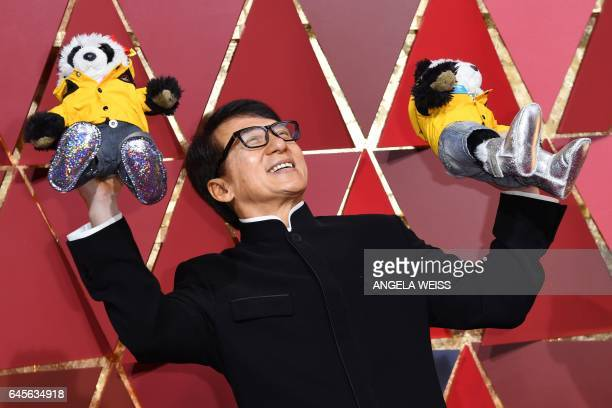 Hong Kong actor Jackie Chan poses as he arrives on the red carpet for the 89th Oscars on February 26 2017 in Hollywood California / AFP / ANGELA WEISS