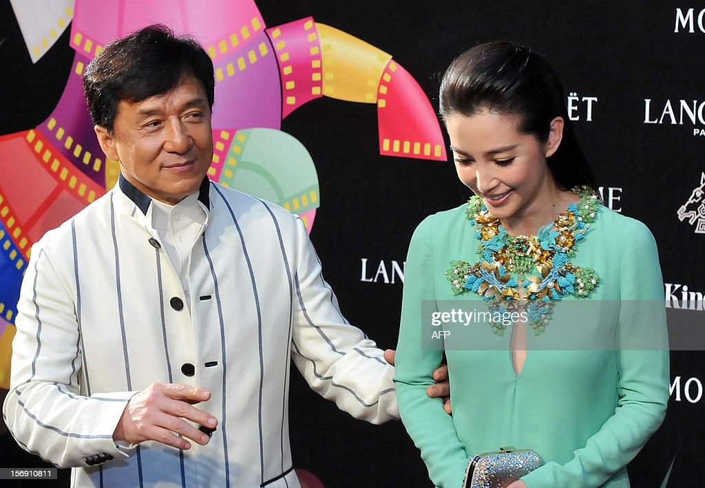 Hong Kong actor Jackie Chen (L) and Chinese actress Li Bingbing arrive at the 49th Golden Horse Film Awards in Ilan on November 24, 2012. A Chinese police drama featuring a cast mainly of amateur actors became the surprise best picture winner at Taiwan's annual Golden Horse Awards, dubbed the Chinese-language 'Oscars.' AFP PHOTO / Mandy CHENG
