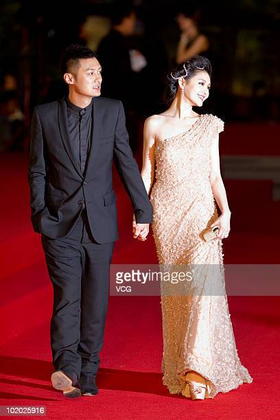 Hong Kong actor Shawn Yue and Taiwanese actress Barbie Hsu pose on the red carpet during the 13th Shanghai Film Festival on June 12 2010 in Shanghai...