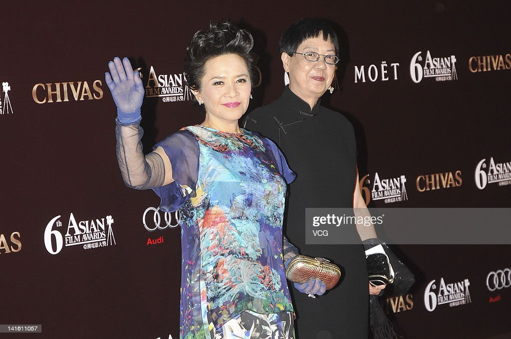 Hong Kong actress Deannie Yip (L) and director <a gi-track='captionPersonalityLinkClicked' href=/galleries/search?phrase=Ann+Hui&family=editorial&specificpeople=2554073 ng-click='$event.stopPropagation()'>Ann Hui</a> pose at the red carpet during the 6th Asian Film Awards at Hong Kong Convention and Exhibition Center on March 19, 2012 in Hong Kong, Hong Kong.