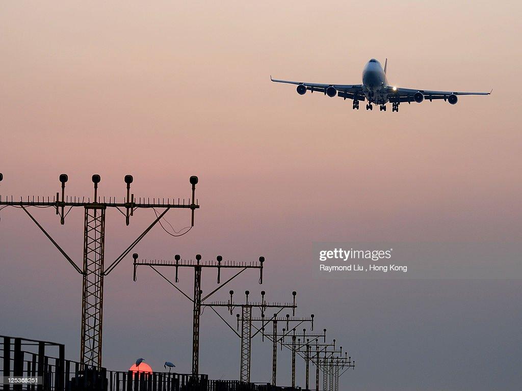 Hong Kong airport with view of landing aircraft