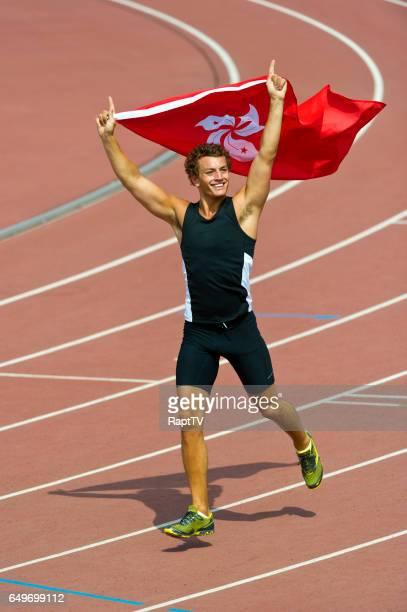 Hong Kong Athlete celebrates with flag.