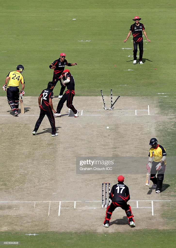 Hong Kong attempt a run out during of the Papua New Guinea v Hong Kong Quarter Final match at the ICC World Twenty20 Qualifiers at the Zayed Cricket Stadium on November 28, 2013 in Abu Dhabi, United Arab Emirates.