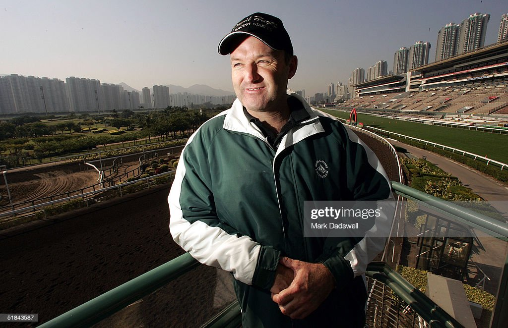 Hong Kong based trainer David Hayes watches trackwork for the Cathay Pacific Hong Kong International Races at Sha Tin Racecourse on December 10 2004...