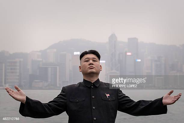 Hong Kong born Australian named Howard and impersonator of North Korean leader Kim JongUn strikes a pose in front of Victoria Harbour in Hong Kong on...