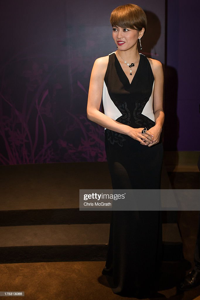Hong Kong Cantopop singer and actress Gigi Leung attends the opening of the Cartier Naturellement Exhibition at the Cartier Flagship store at ION Orchard August 2, 2013 in Singapore.