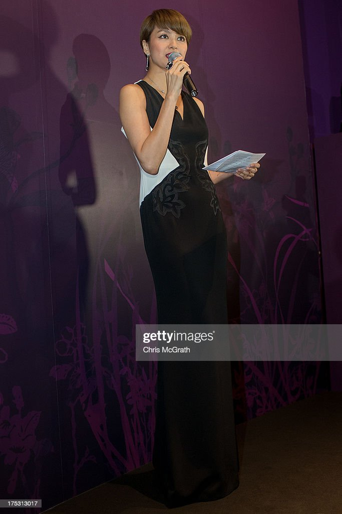 Hong Kong Cantopop singer and actress Gigi Leung gives a speech at the opening of the Cartier Naturellement Exhibition at the Cartier Flagship store at ION Orchard August 2, 2013 in Singapore.
