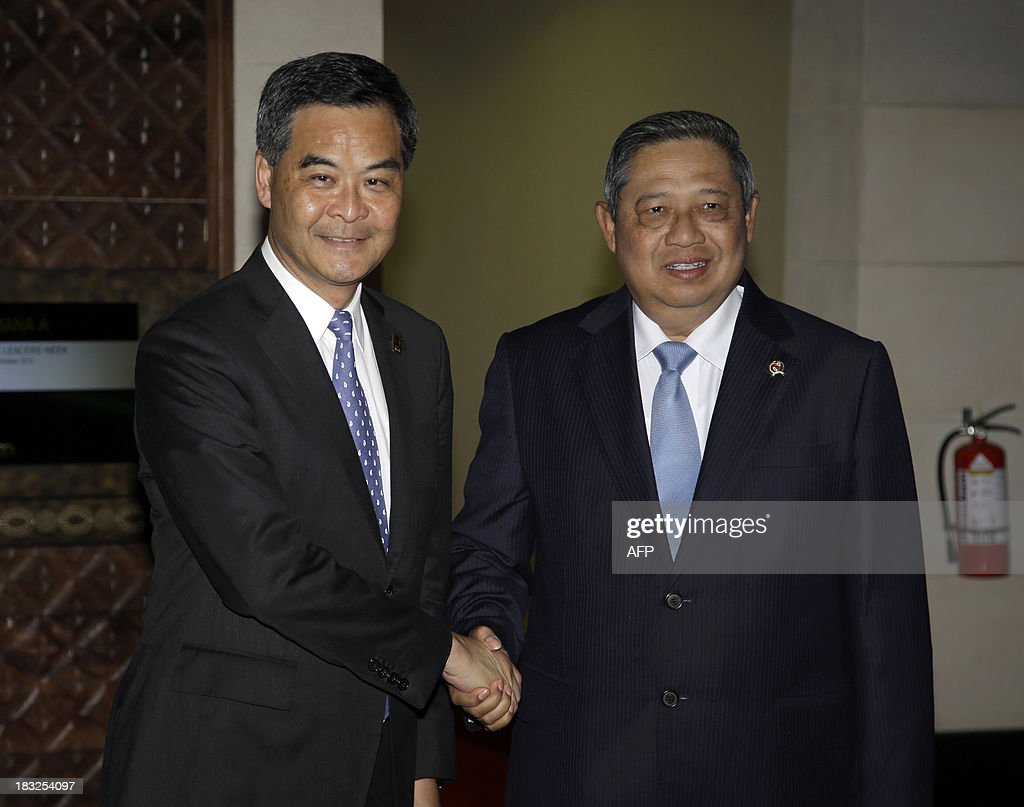 Hong Kong Chief Executive Leung Chun-ying (L) is greeted by Indonesia's President Susilo Bambang Yudhoyono shortly before a bilateral meeting on the sidelines of the Asia-Pacific Economic Cooperation (APEC) Summit in Nusa Dua on the Indonesian resort island of Bali on October 6, 2013. Leaders of the 21-member APEC grouping are arriving in Bali ahead of the leader's summit on October 7-8. AFP PHOTO / DITA ALANGKARA