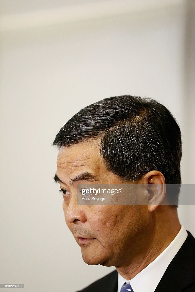 Hong Kong Chief Executive Leung Chunying speaks to Hong Kong journalists at a press conference during the APEC Summit on October 6 2013 in Nusa Dua...