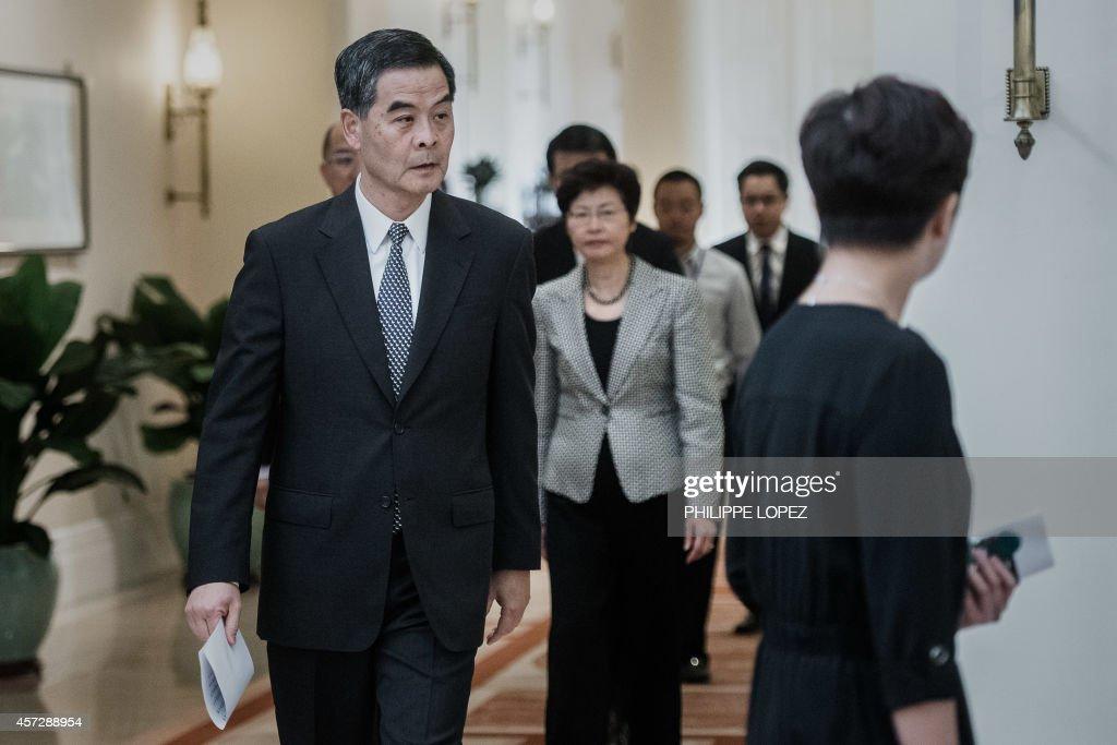 Hong Kong Chief Executive Leung Chunying walks down a corridor before a press conference in Hong Kong on October 16 2014 Hong Kong's embattled leader...