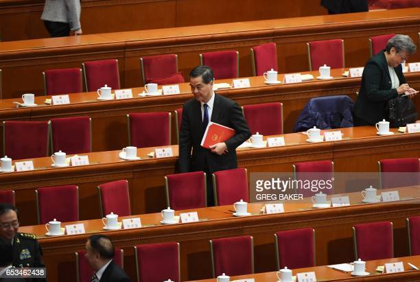 Hong Kong Chief Executive Leung Chunying walks out after the closing session of the National People's Congress China's legislature at the Great Hall...