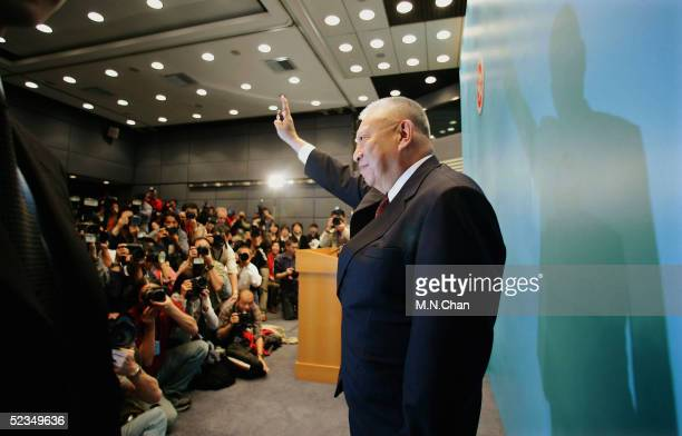 Hong Kong Chief Executive Tung Cheehwa waves after announcing his resignation during a news conference on March 10 2005 in Hong Kong China Tung...