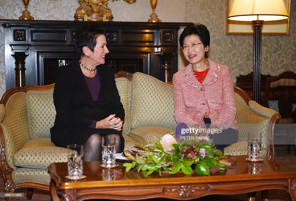 Hong Kong Chief Secretary Carrie Lam (R) speaks with Lord Mayor of Sydney Clover Moore (L) during their meeting at the Town Hall in Sydney on September 17, 2015. Lam is on a visit to Australia following the governments legislation to implement the China free trade agreement (FTA) to urge Australia to open FTA negotiations with Hong Kong as the special administrative region of China. AFP PHOTO / POOL / Peter PARKS