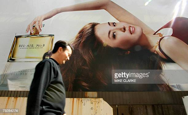 A man walks past a billboard advertising for a perfume in front of Residence BelAir on the South side of Hong Kong 08 February 2007 Residence BelAir...