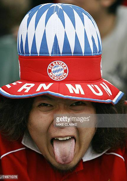Bayern Munich fan gestures during a match in Hong Kong 30 June 2007 Bayern Munich and Sao Paulo teams were competing in a football the HKSAR 10th...