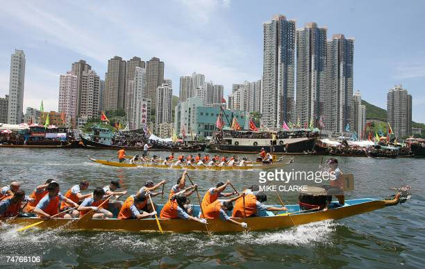 Competitors take part in Dragon boat races in the old fishing town of Aberdeen in Hong Kong 19 June 2007 The sport itself dates back some 2000 years...