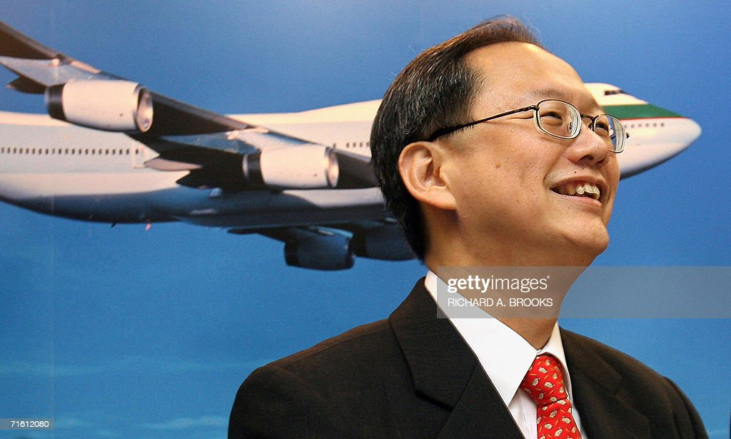 Hong Kong flag carrier Cathay Pacific's chief executive Philip Chen smiles at the start of a press conference about the company's first half profits...