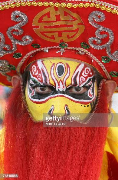 Masked dancers are seen on the outlying island of Cheung Chau situated close to Hong Kong 24 May 2007 The traditional 'bun festival' is held every...