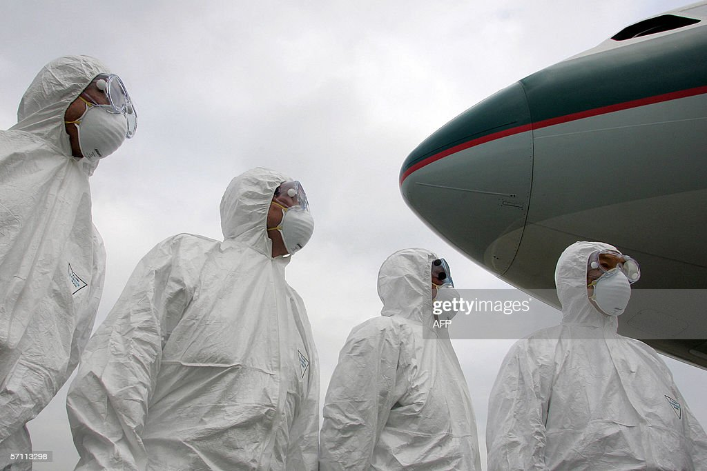 Members of Hong Kong's Health Department wear protective suits during an exercise held at Hong Kong International Airport 17 March 20096 to simulate...