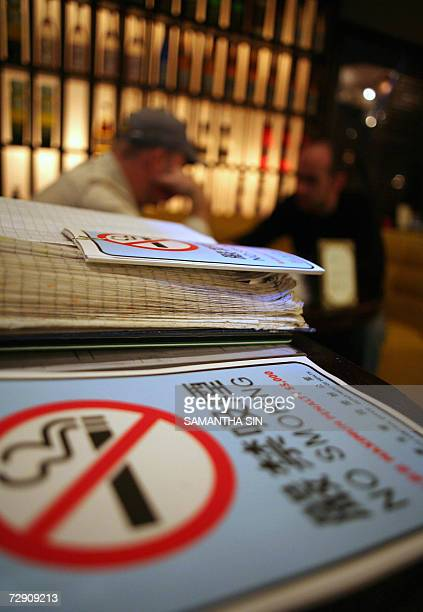 'No Smoking' leaflets are seen having been distributed by the Department of Health at a local restaurant in Hong Kong 01 January 2007 After partying...