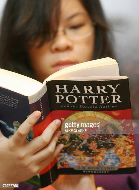 People anxiously read the final chapter in the Harry Potter series 'Harry Potter and The Deathly Hallows' outsdie a bookshop in Hong Kong 21 July...