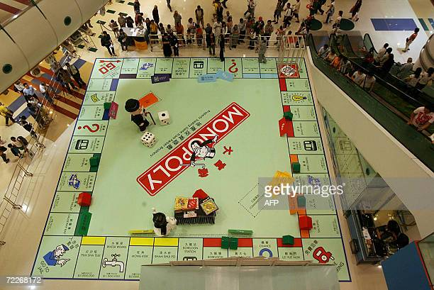 People watch a giant Monopoly board as a game is about to get underway in Hong Kong 26 October 2006 The promotion for the game will feature the...