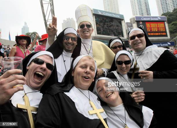 Supporters dress up as nuns and the Pope as they party in the South Stand of Hong Kong Stadium during action at the Hong Kong Rugby Sevens tournament...