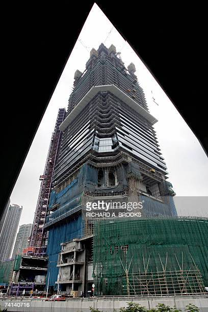TO GO WITH HONGKONGHANDOVER10YEARSARCHITECTURE by Mark McCord The unfinished International Commerce Centre building on the Kowloon side of Hong Kong...