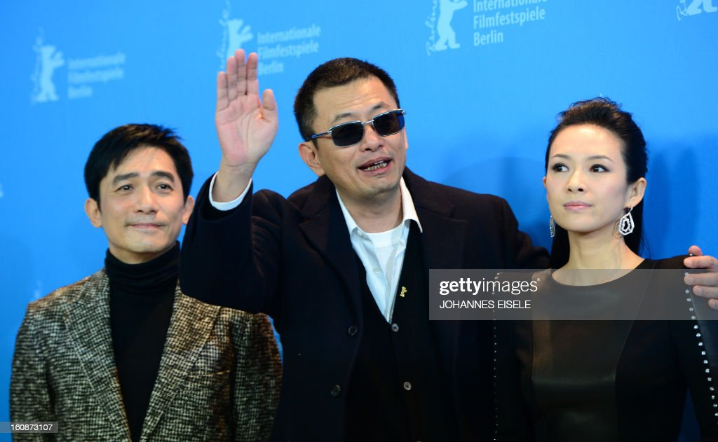 Hong Kong Chinese director Wong Kar-Wai (C), jury president of the 63rd Berlinale film festival, poses with Chinese actors Tony Leung (L) and Zhang Ziyi (R) during a photocall for their film Yi dai zong shi (The Grandmaster) in Berlin, February 7, 2013. The 63rd Berlin film festival opens with a gala screening of Chinese director Wong Kar Wai's martial arts epic about the mentor of kung fu superstar Bruce Lee. AFP PHOTO / JOHANNES EISELE