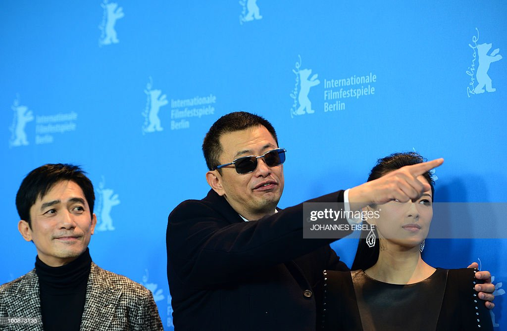 Hong Kong Chinese director Wong Kar-Wai (C), jury president of the 63rd Berlinale film festival, poses with Chinese actors Tony Leung (L) and Zhang Ziyi (R) during a photocall for their film Yi dai zong shi (The Grandmaster) in Berlin, February 7, 2013. The 63rd Berlin film festival opens with a gala screening of Chinese director Wong Kar Wai's martial arts epic about the mentor of kung fu superstar Bruce Lee.