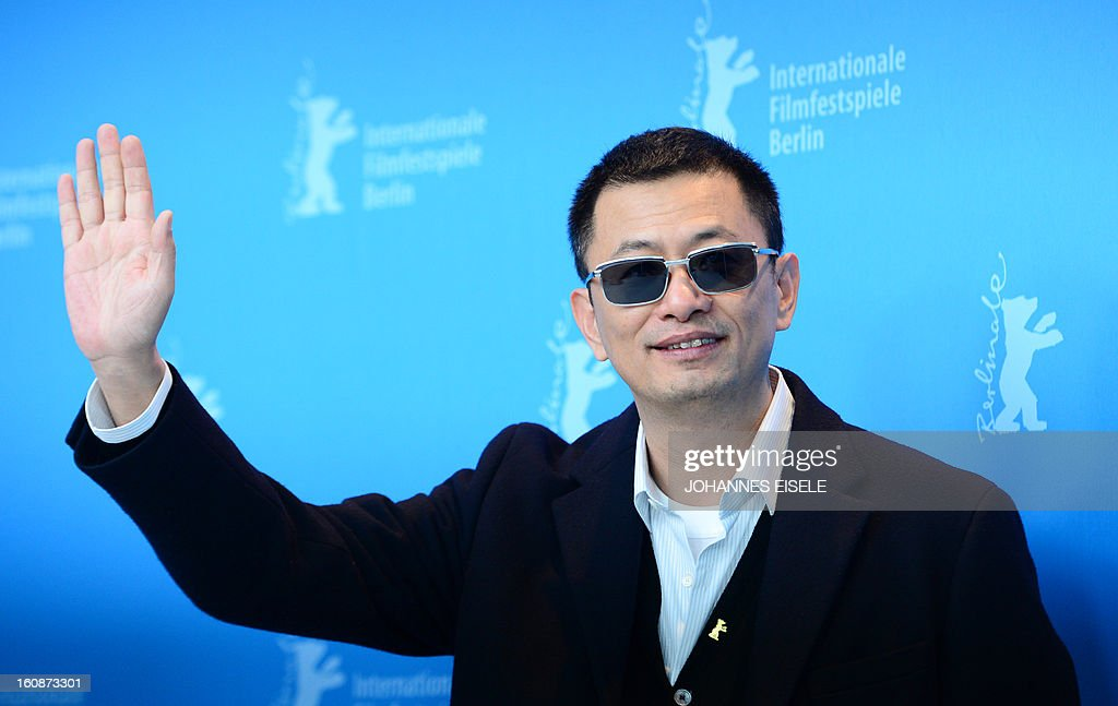 Hong Kong Chinese director Wong Kar-Wai (C), jury president of the 63rd Berlinale film festival, poses during a photocall for his film 'Yi dai zong shi' (The Grandmaster) in Berlin, February 7, 2013. The 63rd Berlin film festival opens with a gala screening of Chinese director Wong Kar Wai's martial arts epic about the mentor of kung fu superstar Bruce Lee.