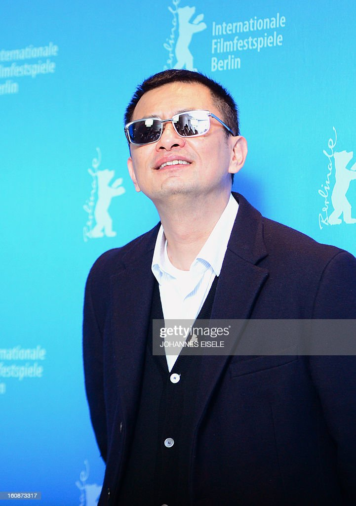 Hong Kong Chinese director Wong Kar-Wai, jury president of the 63rd Berlinale film festival, poses during a photocall for his film 'Yi dai zong shi' (The Grandmaster) in Berlin, February 7, 2013. The 63rd Berlin film festival opens with a gala screening of Chinese director Wong Kar Wai's martial arts epic about the mentor of kung fu superstar Bruce Lee. AFP PHOTO / JOHANNES EISELE ALTERNATIVE CROP