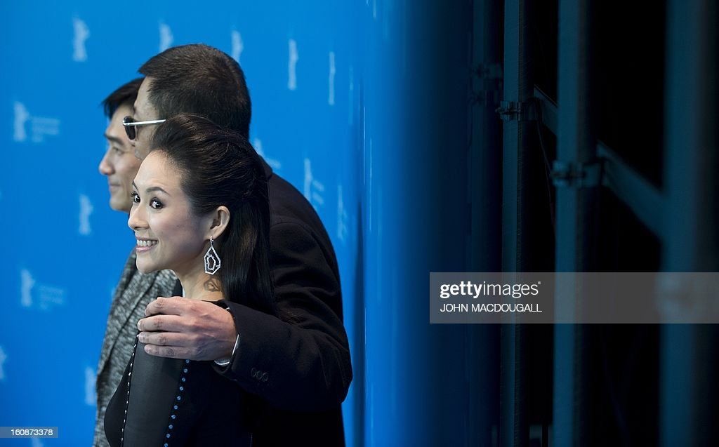 Hong Kong Chinese director Wong Kar-Wai (C), jury president of the 63rd Berlinale film festival, poses with Chinese actors Tony Leung (L) and Zhang Ziyi (R) during a photocall for the film Yi dai zong shi (The Grandmaster) in Berlin, February 7, 2013. The 63rd Berlin film festival opens with a gala screening of Chinese director Wong Kar Wai's martial arts epic about the mentor of kung fu superstar Bruce Lee. AFP PHOTO / JOHN MACDOUGALL