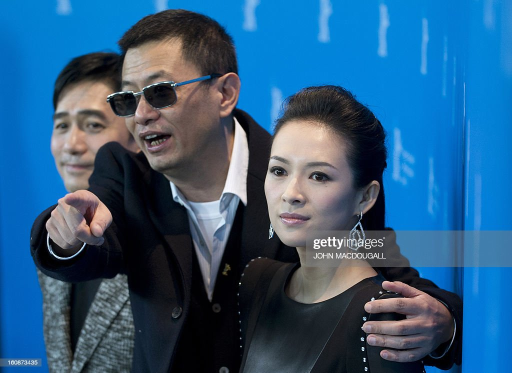 Hong Kong Chinese director Wong Kar-Wai (C), jury president of the 63rd Berlinale film festival, poses with Chinese actors Tony Leung (L) and Zhang Ziyi (R) during a photocall for the film Yi dai zong shi (The Grandmaster) in Berlin, February 7, 2013. The 63rd Berlin film festival opens with a gala screening of Chinese director Wong Kar Wai's martial arts epic about the mentor of kung fu superstar Bruce Lee.