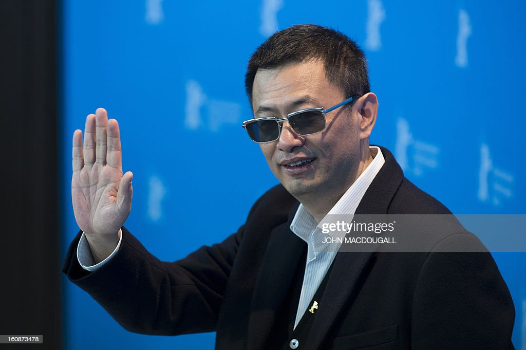 Hong Kong Chinese director Wong Kar-Wai, jury president of the 63rd Berlinale film festival, poses during a photocall for the film Yi dai zong shi (The Grandmaster) in Berlin, February 7, 2013. The 63rd Berlin film festival opens with a gala screening of Chinese director Wong Kar Wai's martial arts epic about the mentor of kung fu superstar Bruce Lee. AFP PHOTO / JOHN MACDOUGALL