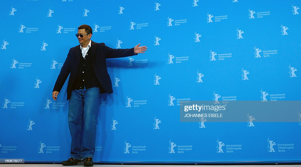 Hong Kong Chinese director Wong Kar-Wai, jury president of the 63rd Berlinale film festival, poses during a photocall for his film 'Yi dai zong shi' (The Grandmaster) in Berlin, February 7, 2013. The 63rd Berlin film festival opens with a gala screening of Chinese director Wong Kar Wai's martial arts epic about the mentor of kung fu superstar Bruce Lee. AFP PHOTO / JOHANNES EISELE