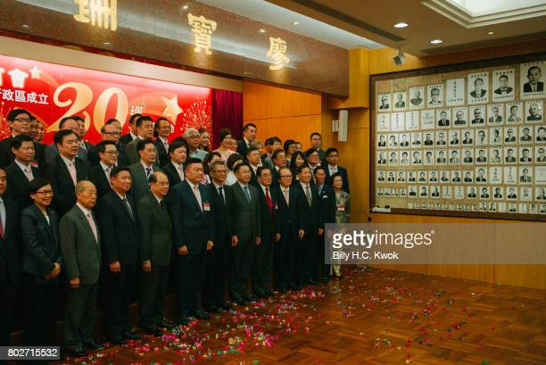 Hong Kong Chiu Chow Chamber of Commerce members celebrate ahead of 20th anniversary of the handover from Britain to China on May 23 2017 in Hong Kong...