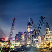 Hong Kong, cranes in front of skyline
