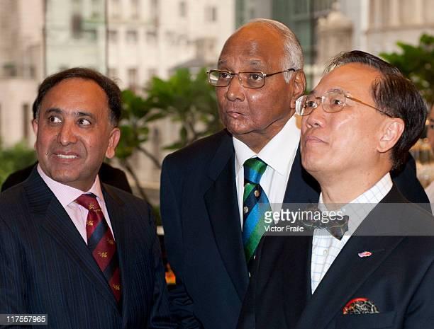 Hong Kong Cricket Association President Shahzada Ahmed ICC President Sharad Pawar and Hong Kong Chief Executive Donald Tsang look at a cricket video...