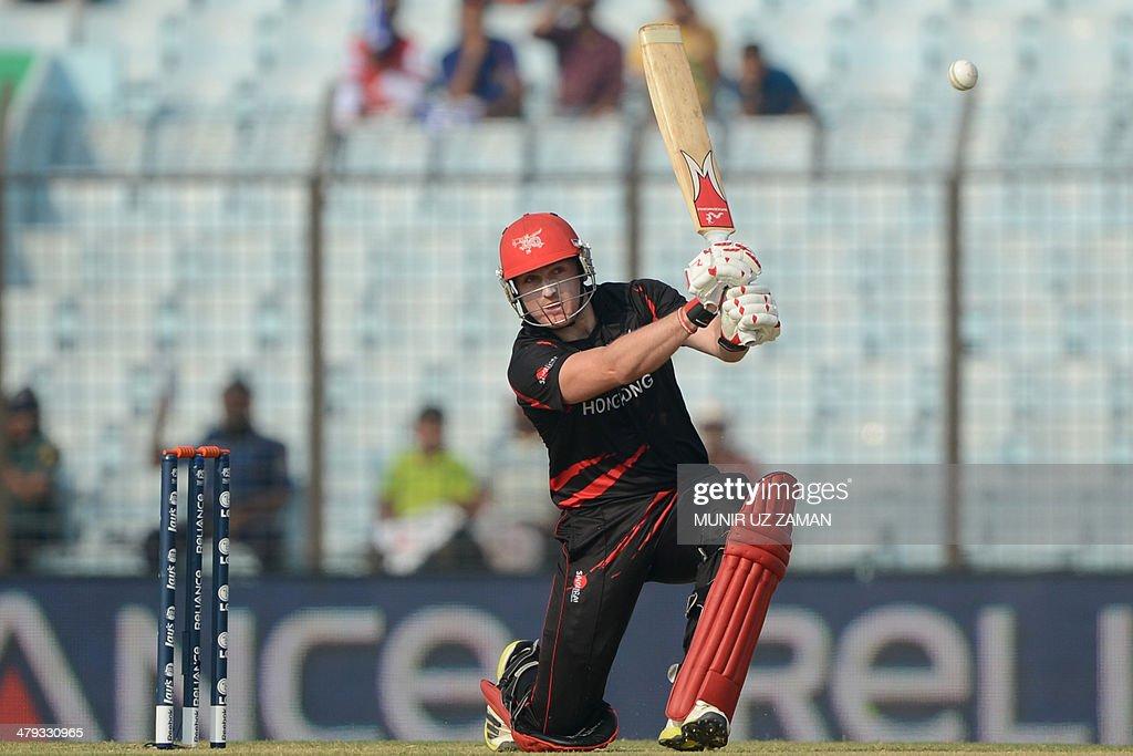 Hong Kong cricket captain Jamie Atkinson plays a shot during the ICC Twenty20 World Cup fifth qualifying cricket match between Hong Kong and...