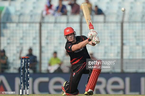 Hong Kong cricket captain Jamie Atkinson plays a shot during the ICC Twenty20 World Cup fifth qualifying cricket match between Hong Kong and...