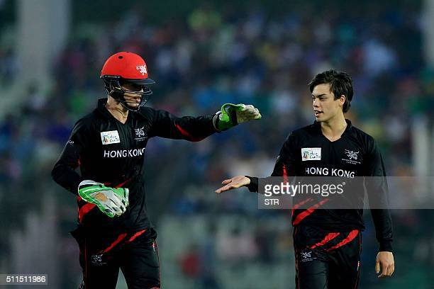 Hong Kong cricketer MS Chapman celebrates with a teammate during The Asia Cup T20 qualifying match between Hong Kong and United Arab Emirates at...