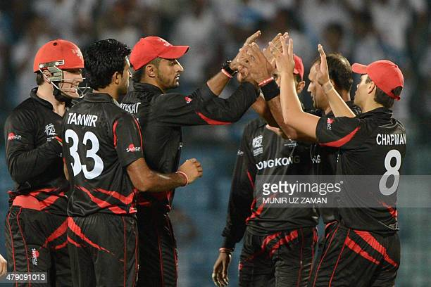 Hong Kong cricketers celebrate after the dismissal of Nepal cricket captain Paras Khadka during the ICC Twenty20 World Cup second qualifying cricket...