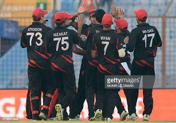 Hong Kong cricketers celebrate after the dismissal of unseen Afghan cricketer Najeeb Tarakai during the ICC Twenty20 World Cup fifth qualifying...
