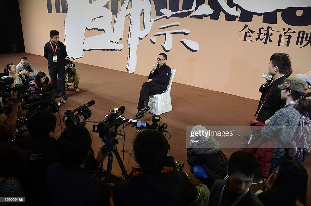 Hong Kong director Wong Kar Wai (C) responds to questions during a press conference for his new film 'The Grandmaster' ahead of its premier in Beijing on January 6, 2013. Hong Kong director Wong Kar-wai's long awaited new film The Grandmaster, about battling martial artists, received its first public showing in Beijing on January 6. WANG