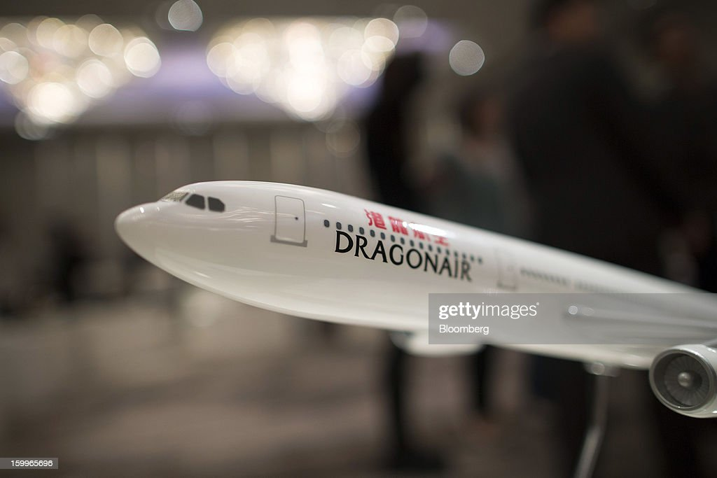 A Hong Kong Dragon Airlines Ltd. (Dragonair) model aircraft is displayed during a news conference in Hong Kong, China, on Thursday, Jan. 24, 2013. Dragonair is to upgrade cabins and add new destinations this year. Photographer: Jerome Favre/Bloomberg via Getty Images