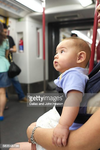 hong kong eurasian baby boy traveling on a train stock photo getty images. Black Bedroom Furniture Sets. Home Design Ideas